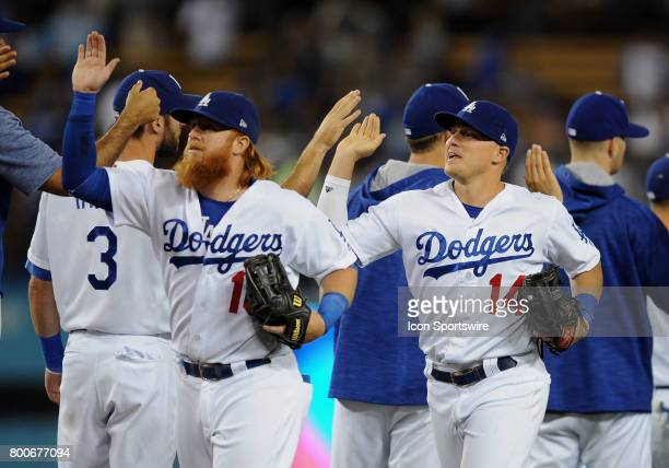 Los Angeles Dodgers third baseman Justin Turner and center fielder Joc Pederson head off the field after the Dodgers defeated the Colorado Rockies 4...