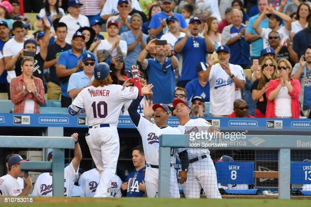 Los Angeles Dodgers third baseman Justin Turner gets a high five from manager Dave Roberts during an MLB game between the Arizona Diamondbacks and...