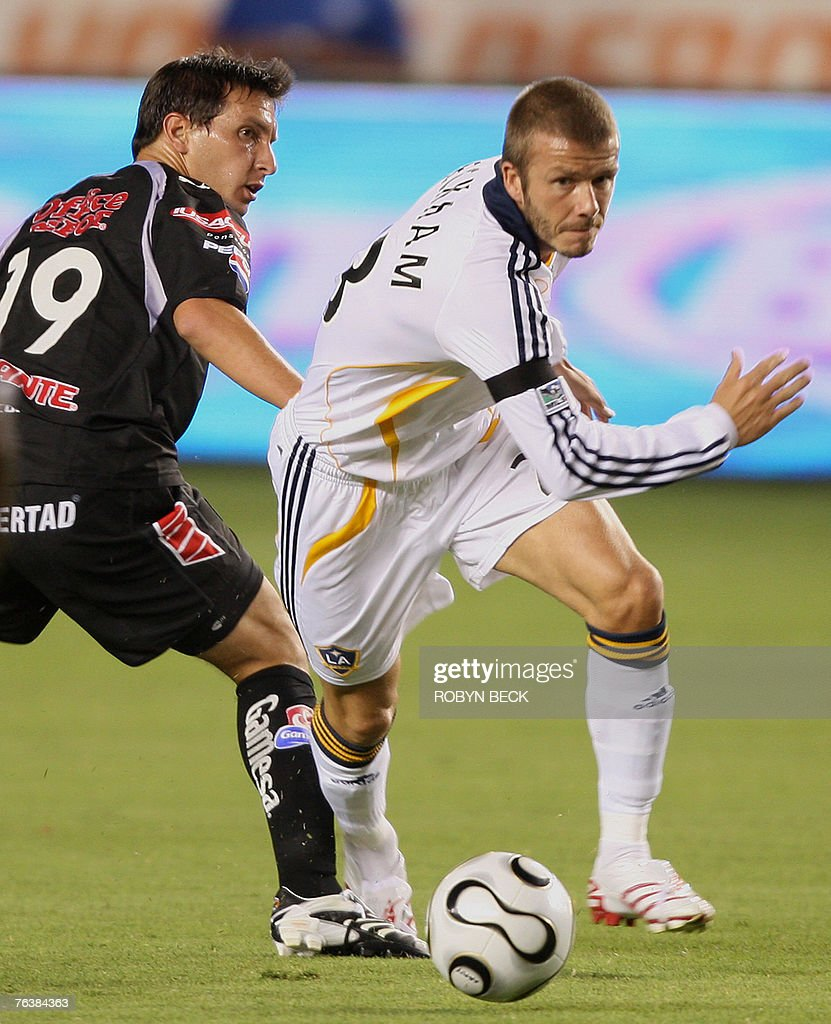 Los Angeles Galaxy captain David Beckham and CF Pachuca's Christian Gimenez during first half Superliga finals action 29 August 2007 at the Home...