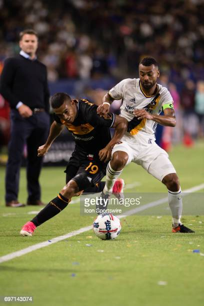 Los Angeles Galaxy defender Ashley Cole battles against Houston Dynamo forward Mauro Manotas for the ball during the game between the LA Galaxy and...