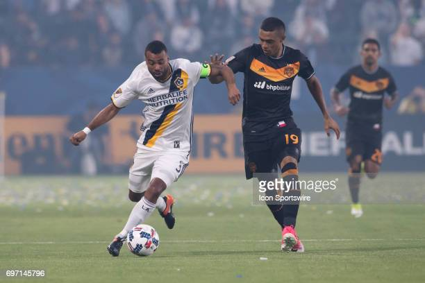 Los Angeles Galaxy defender Ashley Cole moves the ball against Houston Dynamo forward Mauro Manotas during the game between the LA Galaxy and the...