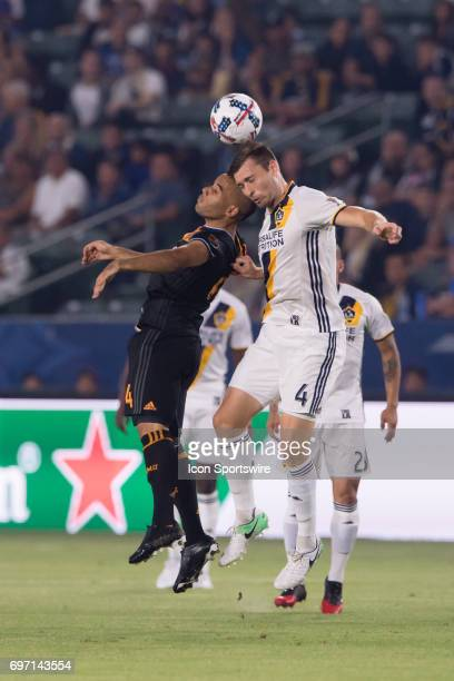 Los Angeles Galaxy defender Dave Romney and Houston Dynamo defender Agus both go up to head the ball during the game between the LA Galaxy and the...