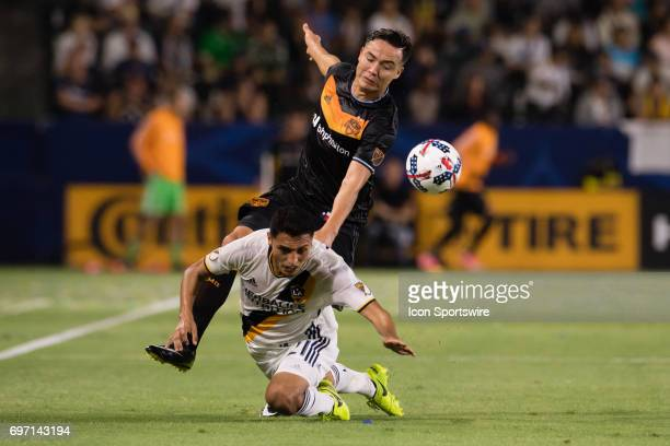Los Angeles Galaxy defender Hugo Arellano works to defend against Houston Dynamo forward Erick Torres during the game between the LA Galaxy and the...