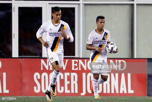 Los Angeles Galaxy forward Giovani dos Santos hurries the ball back to the center circle after LA cut the deficit to 43 during a regular season MLS...