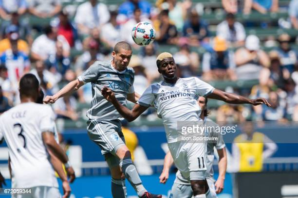 Los Angeles Galaxy forward Gyasi Zerdes and Seattle Sounders midfielder Osvaldo Alonso both go up to head the ball during the game between the LA...