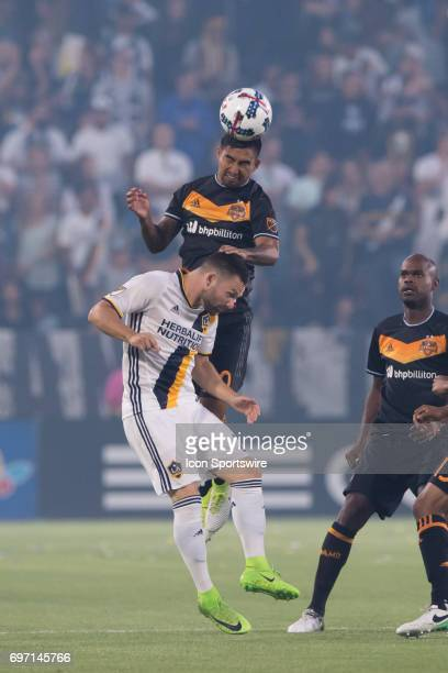 Los Angeles Galaxy forward Jack Mcinnerney battles for the header against Houston Dynamo defender A J DeLaGarza during the game between the LA Galaxy...