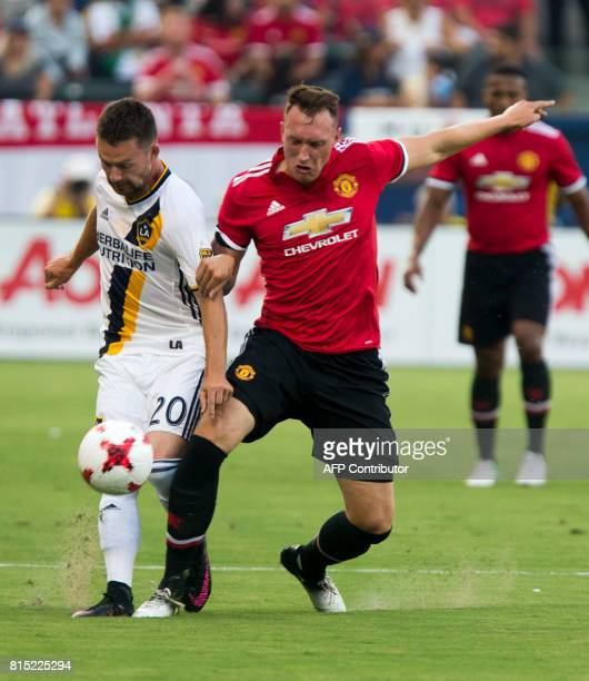 Los Angeles Galaxy Jcck Mcinerney and Manchester United Marouane Phil Jones battle for the ball during the second half of a national friendly soccer...
