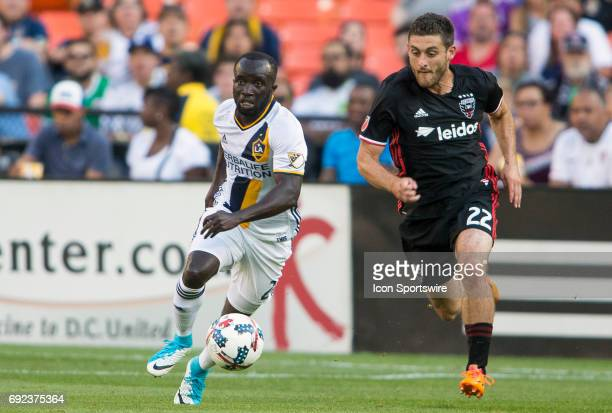 Los Angeles Galaxy midfielder Ema Boateng races away from DC United defender Chris Korb during a MLS match between DC United and the Los Angles...
