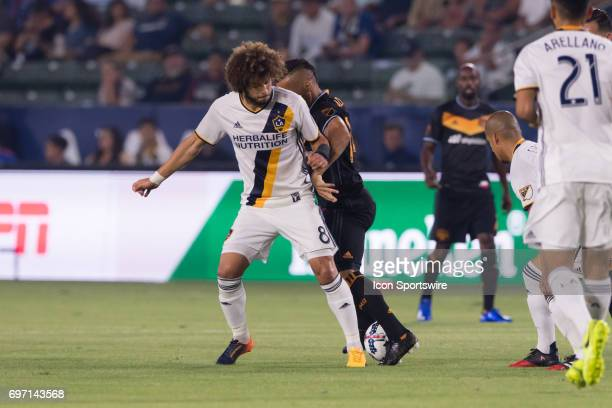 Los Angeles Galaxy midfielder Joao Pedro battles for the ball during the game between the LA Galaxy and the Houston Dynamo on June 17 at StubHub...