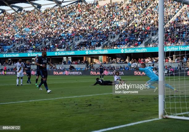 Los Angeles Galaxy midfielder Joao Pedro scores as San Jose Earthquakes goalkeeper David Bingham misses the block during the MLS match between the...