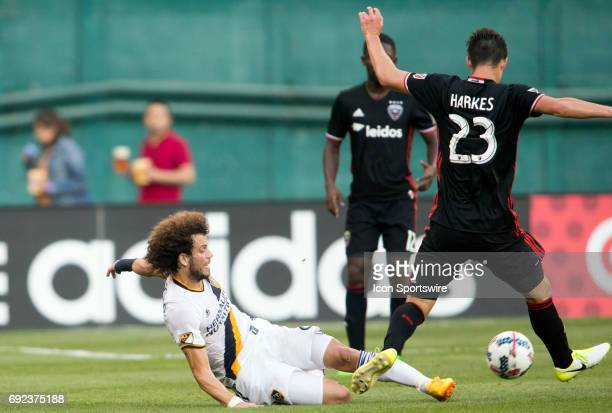 Los Angeles Galaxy midfielder Joao Pedro slides into DC United midfielder Ian Harkes during a MLS match between DC United and the Los Angles Galaxy...