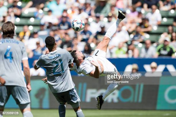 Los Angeles Galaxy midfielder Romain Alessandrini goes for a bicycle kick shot infant of the goal during the game between the LA Galaxy and the...