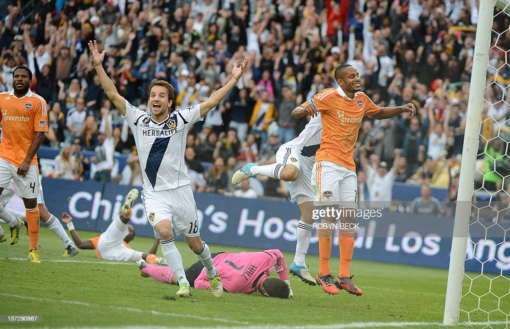 Los Angeles Galaxy's Mike Magee celebrates as Omar Gonzalez scores a goal against the Houston Dynamo during the Major League Soccer Cup match...