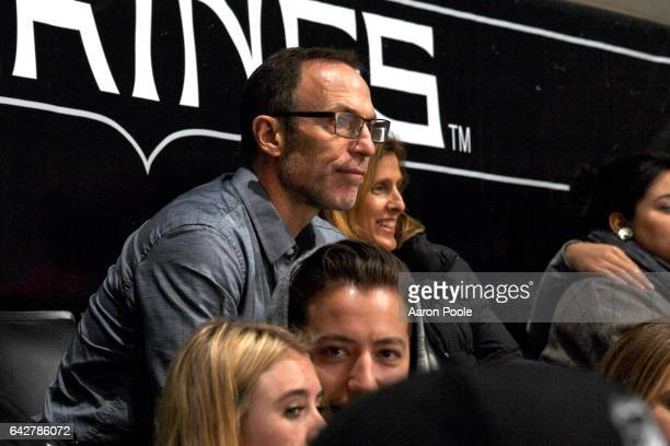Los Angeles Kings alumni Ray Ferraro left and former Kings radio analyst Cammi Granato watch the game against the Florida Panthers on February 18...