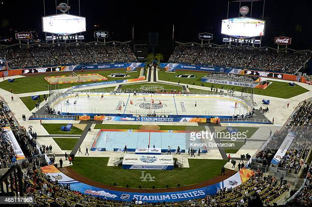Los Angeles Kings and Anaheim Ducks skate in the baseball diamond during the 2014 Coors Light Stadium Series at Dodger Stadium on January 25 in Los...