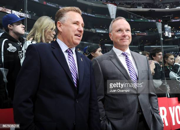 Los Angeles Kings Assistant Coaches Dan Nachbauer and Dave Lowry sport lavender ties in support of Hockey Fights Cancer night before a game against...