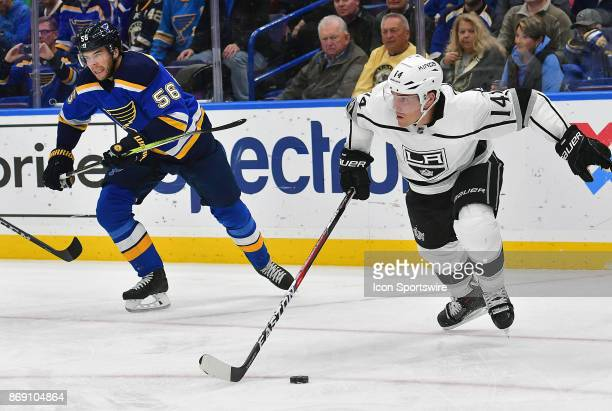 Los Angeles Kings center Michael Cammalleri skates with the puck ahead of St Louis Blues left wing Magnus Paajarvi during a National Hockey League...