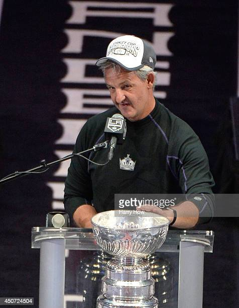 Los Angeles Kings coach Darryl Sutter touches the Stanley Cup during the Los Angeles Kings Victory Parade And Rally on June 16 2014 in Los Angeles...