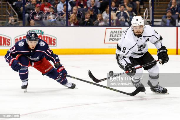 Los Angeles Kings defenseman Drew Doughty flips the puck in the air to keep it from Columbus Blue Jackets right wing Cam Atkinson during the third...