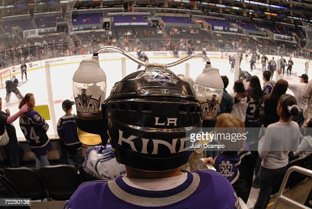 Los Angeles Kings fan wears a beer helmet as he watches the NHL game against the Dallas Stars on October 14 2006 at the Staples Center in Los Angeles...