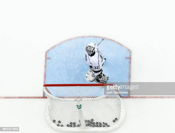 Los Angeles Kings goalie Jonathan Quick stands in front of a goal full of hockey pucks during warmups in a game between the Columbus Blue Jackets and...