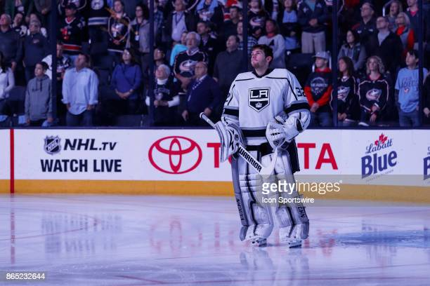 Los Angeles Kings goalie Jonathan Quick watches the scoreboard as a video plays about the first black NHL player Willie O'Ree before the first period...