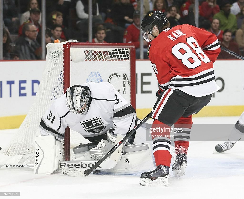 Los Angeles Kings goalie Martin Jones (31) blocks a puck touched by Chicago Blackhawks right wing Patrick Kane (88) during the first period at the United Center in Chicago on Monday, Dec. 30, 2013.