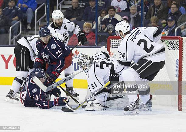 Los Angeles Kings goalie Peter Budaj stops a shot from Columbus Blue Jackets right wing Josh Anderson during the first period of the game on December...