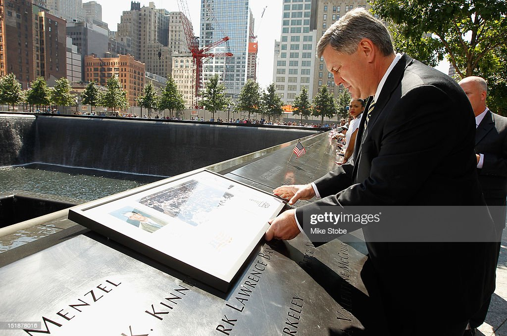 Los Angeles Kings Governor Tim Leiweke lays a plague at the reflexting pool above the engraved names of Garnet 'Ace' Bailey, the Kings' director of pro scouting, and amateur scout Mark Bavis in lower Manhattan at the World Trade Center site on September 12, 2012 in New York City.The Los Angeles Kings felt the loss of Garnet 'Ace' Bailey, the Kings' director of pro scouting, and amateur scout Mark Bavis when hijackers took control of their scheduled Boston-to-Los Angeles flight and crashed the plane into the south tower of New York's World Trade Center.