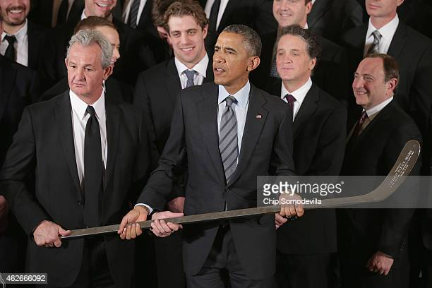 Los Angeles Kings Head Coach Darryl Sutter presents US President Barack Obama with a silver hockey stick as Obama hosted the National Hockey League...