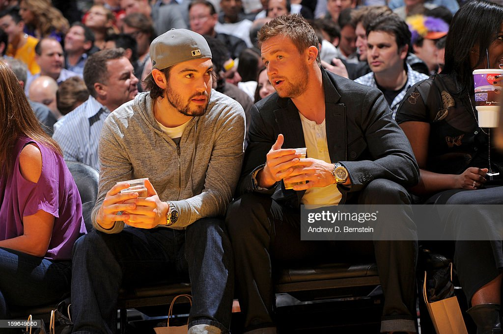 Los Angeles Kings hockey players Drew Doughty and Trevor Lewis attend a game between the Miami Heat and the Los Angeles Lakers at Staples Center on January 15, 2013 in Los Angeles, California.