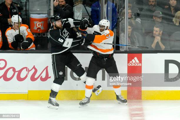 Los Angeles Kings Jake Muzzin delivers a body check to Flyers Wayne Simmonds during their game against the Philadelphia Flyers at the Staples Center...