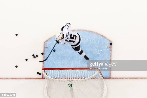 Los Angeles Kings left wing Andy Andreoff clears pucks from the net during warmups in a game between the Columbus Blue Jackets and the Los Angeles...