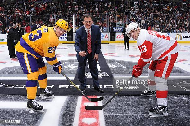 Los Angeles Kings Legend and Detroit Red Wings assistant coach Tony Granato prepares to drop the ceremonial first puck to Dustin Brown of the Los...