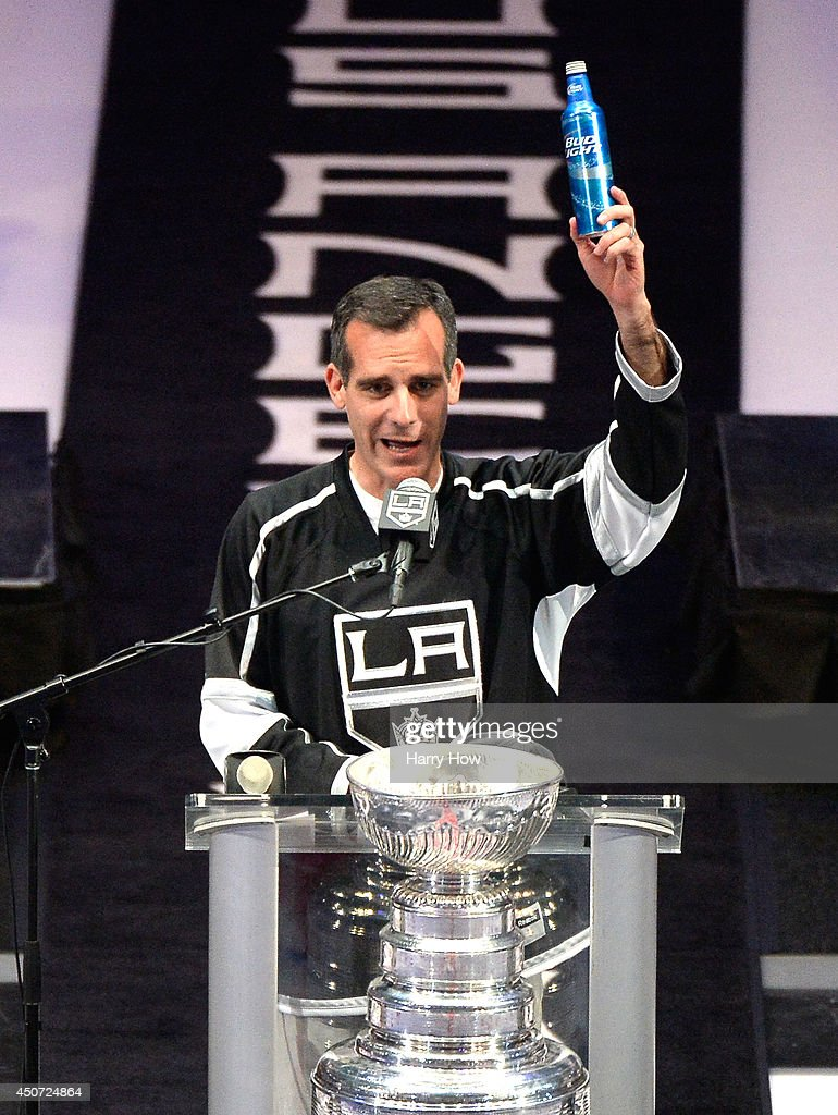 Los Angeles Kings Mayor <a gi-track='captionPersonalityLinkClicked' href=/galleries/search?phrase=Eric+Garcetti&family=editorial&specificpeople=635706 ng-click='$event.stopPropagation()'>Eric Garcetti</a> raises a beer and swears during the Los Angeles Kings Victory Parade And Rally on June 16, 2014 in Los Angeles, California.