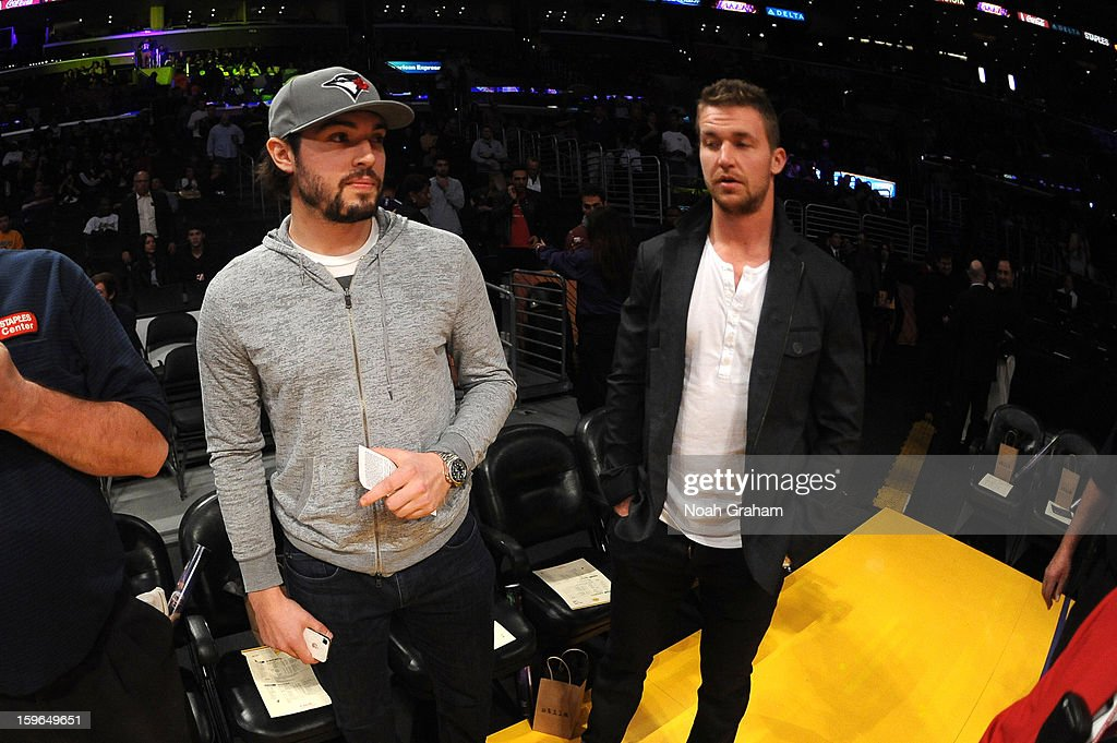 Los Angeles Kings players Drew Doughty and Trevor Lewis attend a game between the Miami Heat and the Los Angeles Lakers at Staples Center on January 15, 2013 in Los Angeles, California.
