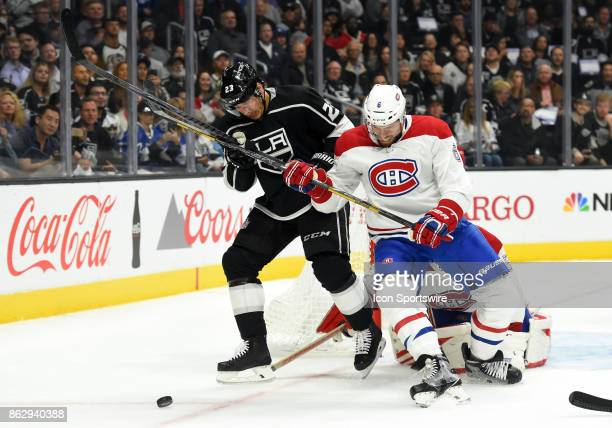 Los Angeles Kings Right Wing Dustin Brown and Montreal Canadiens Defenseman Shea Weber battle for the puck during an NHL game between the Montreal...
