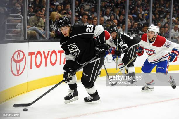 Los Angeles Kings Right Wing Dustin Brown brings the puck out from the corner during an NHL game between the Montreal Canadiens and the Los Angeles...