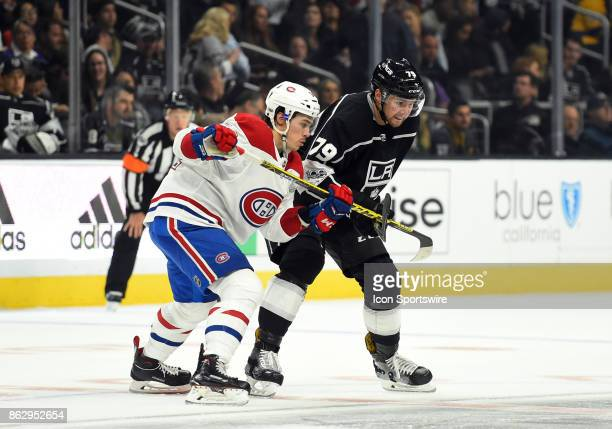 Los Angeles Kings Right Wing Justin Auger guards Montreal Canadiens Left Wing Charles Hudon during a face off during an NHL game between the Montreal...