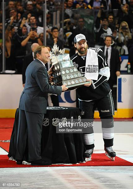 Los Angeles Kings Right Wing Justin Williams [2150] receives the Conn Smythe Trophy during the post game celebration of the Stanley Cup Final between...