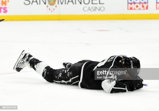 Los Angeles Kings Right Wing Tyler Toffoli lies on the ice with an after being hit in the head during an NHL game between the Montreal Canadiens and...