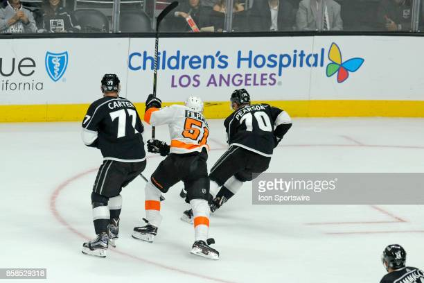 Los Angeles Kings Tanner Pearson and Jeff Carter battle for a loose puck with Flyers Valtteri Filppula during their game against the Philadelphia...