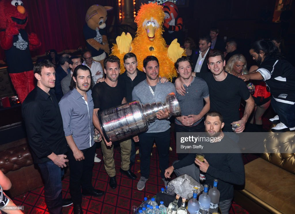 Los Angeles Kings team members <a gi-track='captionPersonalityLinkClicked' href=/galleries/search?phrase=Tyler+Toffoli&family=editorial&specificpeople=6514151 ng-click='$event.stopPropagation()'>Tyler Toffoli</a>, <a gi-track='captionPersonalityLinkClicked' href=/galleries/search?phrase=Drew+Doughty&family=editorial&specificpeople=2085761 ng-click='$event.stopPropagation()'>Drew Doughty</a>, <a gi-track='captionPersonalityLinkClicked' href=/galleries/search?phrase=Jarret+Stoll&family=editorial&specificpeople=204632 ng-click='$event.stopPropagation()'>Jarret Stoll</a>, <a gi-track='captionPersonalityLinkClicked' href=/galleries/search?phrase=Alec+Martinez+-+Ice+Hockey+Player&family=editorial&specificpeople=5537193 ng-click='$event.stopPropagation()'>Alec Martinez</a>, <a gi-track='captionPersonalityLinkClicked' href=/galleries/search?phrase=Brayden+McNabb&family=editorial&specificpeople=4779653 ng-click='$event.stopPropagation()'>Brayden McNabb</a>, Martin Jones, and <a gi-track='captionPersonalityLinkClicked' href=/galleries/search?phrase=Trevor+Lewis&family=editorial&specificpeople=543187 ng-click='$event.stopPropagation()'>Trevor Lewis</a> appear with the Stanley Cup as they celebrate their championship celebration sponsored by Casamingos Tequila and Beau Jeau Champagne at Beacher's Madhouse at the MGM Grand Hotel/Casino on June 19, 2014 in Las Vegas, Nevada.
