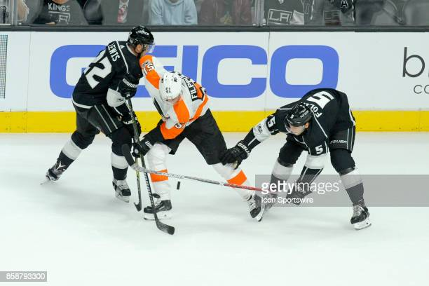Los Angeles Kings Trevor Lewis and Samuel Morin battle with Flyers Valtteri Filppula during their game against the Philadelphia Flyers at the Staples...