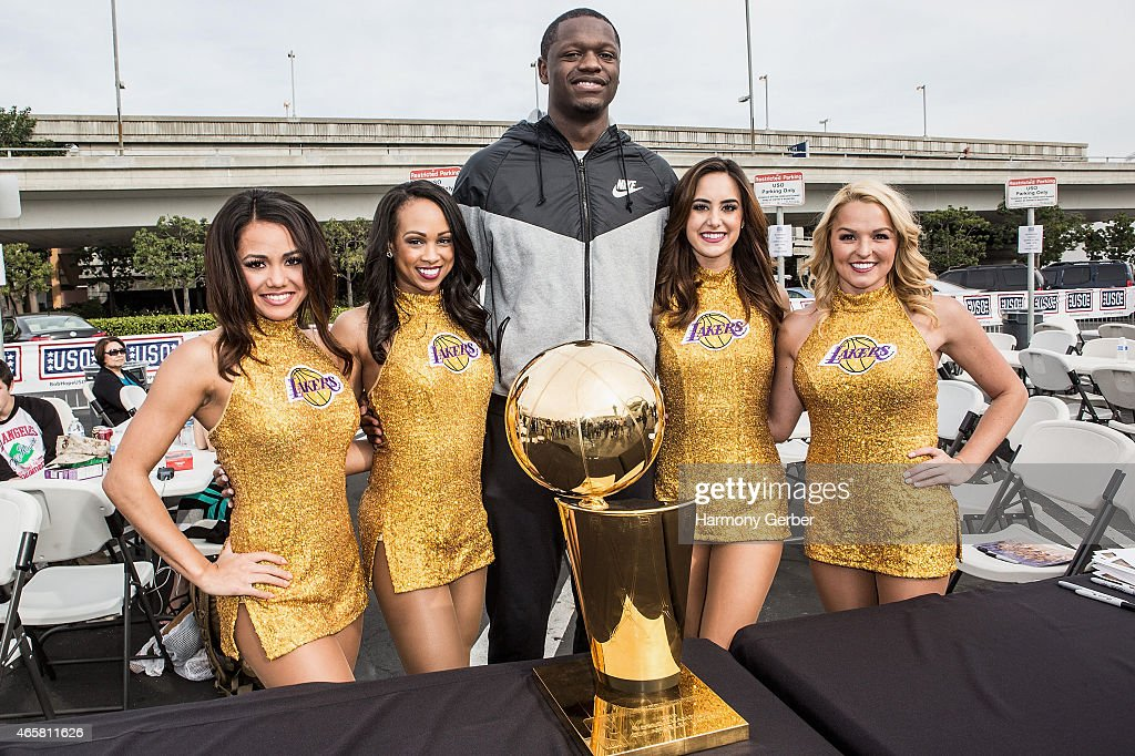 Los Angeles Laker Julius Randle and Laker Girls attend the Bob Hope USO at LAX on March 10 2015 in Los Angeles California