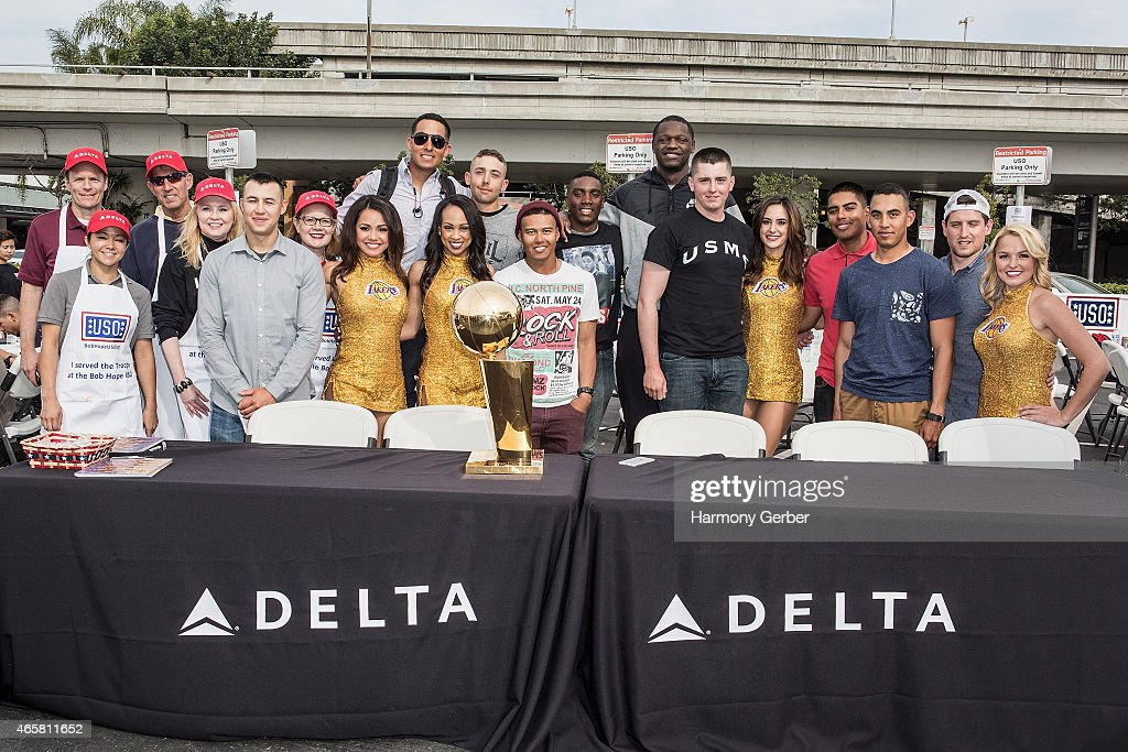 Los Angeles Laker Julius Randle, Laker Girls and U.S. Troops attend the Bob Hope USO at LAX on March 10, 2015 in Los Angeles, California.