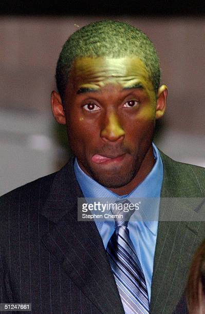 Los Angeles Laker Kobe Bryant sticks his tongue out as he leaves Eagle County Justice Center after the second day of jury selection August 30 2004 in...