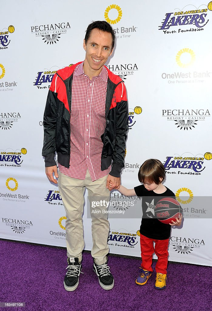 Los Angeles Laker <a gi-track='captionPersonalityLinkClicked' href=/galleries/search?phrase=Steve+Nash+-+Basketball+Player&family=editorial&specificpeople=201513 ng-click='$event.stopPropagation()'>Steve Nash</a> and son Mateo attend the Lakers Casino Night fundraiser benefiting the Lakers Youth Foundation at Club Nokia on March 10, 2013 in Los Angeles, California.