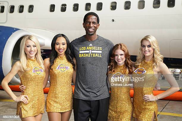 Los Angeles Lakers alumni AC Green and the Lakers Girls attend Delta Airlines' 4th annual 'Holiday in the Hangar' event at LAX Airport on December 10...