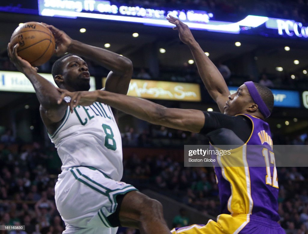 Los Angeles Lakers center Dwight Howard (#12) defends as Boston Celtics power forward Jeff Green (#8) drives for a second quarter basket as the Boston Celtics play the Los Angeles Lakers at TD Garden.